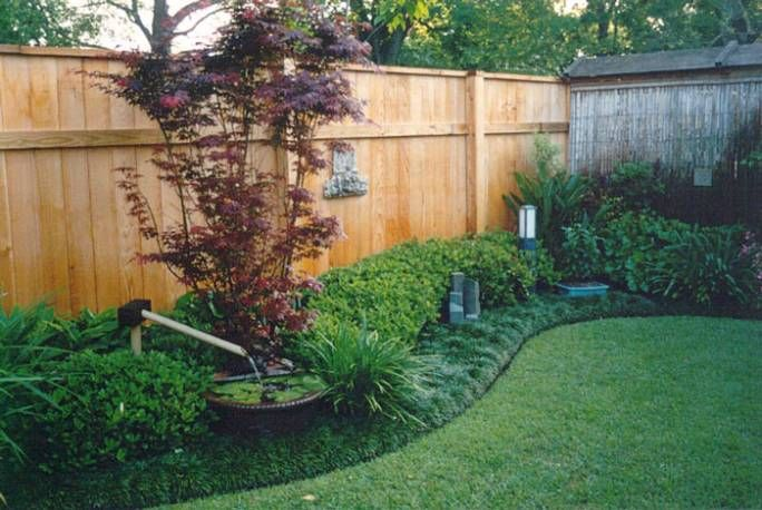 Amazing Landscape Fence #5 Landscaping Along Privacy Fence Ideas