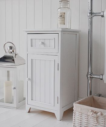 A crisp white freestanding bathroom storage furniture. A narrow
