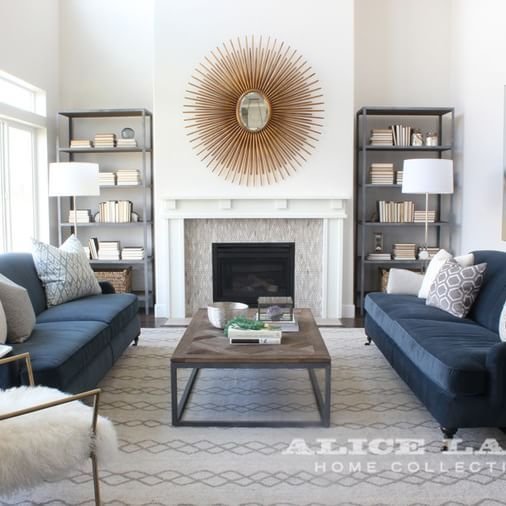Alice Lane Home Collection | Living room with navy sofas and