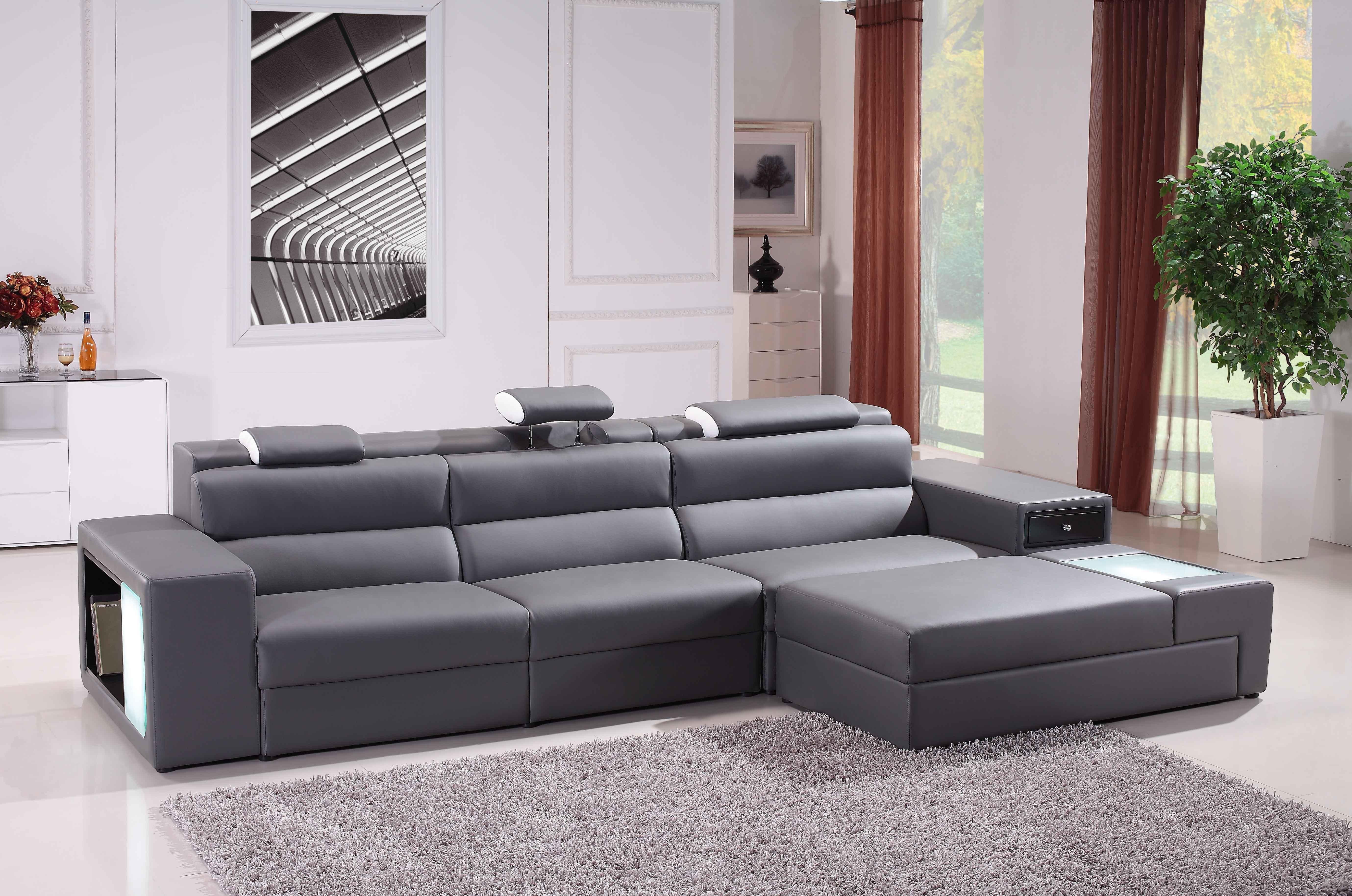 Gray Leather Sleeper Sectional Sofa With Shelf Placed On The White Floor  Plus Gray Fur Rug