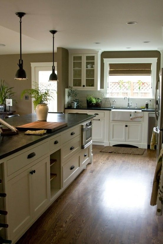 Kitchen color scheme: cream colored cabinets with dark hardware and