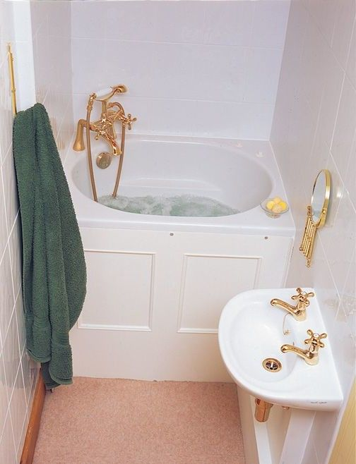 small bathroom idea with corner deep tub with gold-tone faucet stand