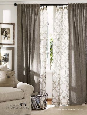 Layered curtains for the living room.. I even like the color. It'd