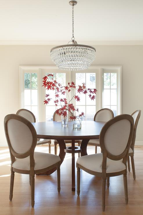 Round Dining Table With Vintage French Fabric Side Chairs In Back