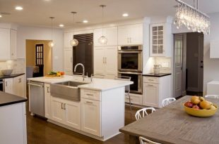 kitchen island with sink and dishwasher and seating | log cabin