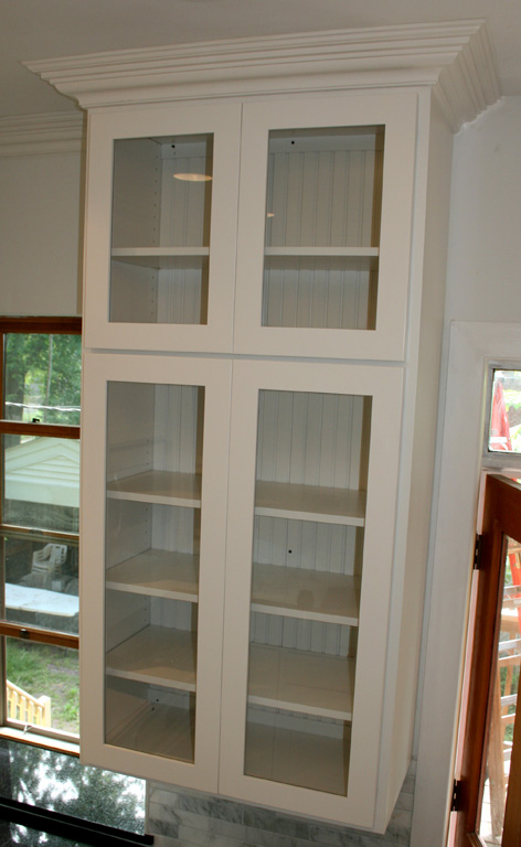 Get perfect kitchen wall cabinets with glass doors for storage