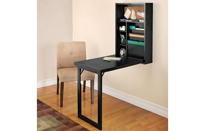 Wall-mounted fold out desk. Clever for small, multi-functional
