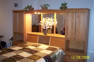 Headboard with Storage and Lights to read at night. Awesome. Oak