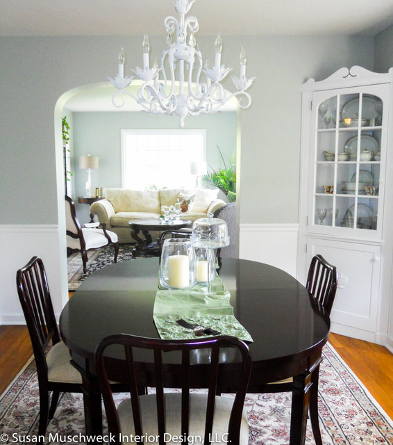 Traditional Dining Room with White Chandelier and Dark Table
