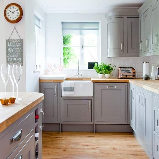Country kitchen with grey painted cabinetry and wooden worktops | A